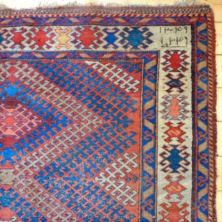 A 19th Century South Caucasian (Karabakh?) rug. Size 245 x 158 cm  An inscribed large South Caucasian, possibly Karabakh, rug. The pile is mostly evenly worn with heavy wear in places; a fragment  ...