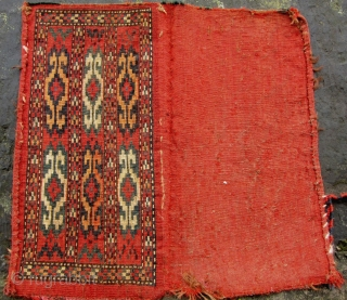 19th Century Yomut Spindle Bag.   Size 54 x 27 cm (pile face only)  With remnants of decorative platted selvedge chord. Red flatwoven back intact, Pile pretty good. Photos taken outside.