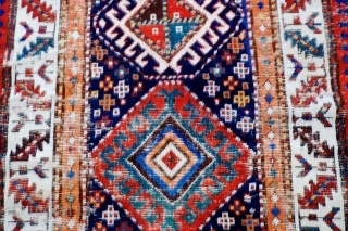 A 19th Century South Caucasian/Northwest Persian Long Rug  Size 299 x 108 cm  A transitional Caucasian/Northwest Persian long rug with very good colours and with original knotted fringes at one end, original  ...