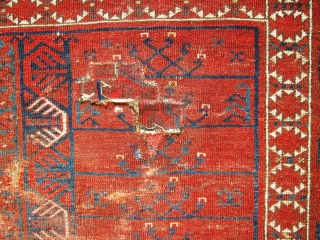 An Ersari Ensi from the second half of the 19th. century  Size 188 x 150cm approx.  In poor overall condition, with repairs,fold wear, tears and a glue stain on the back. This is an  ...