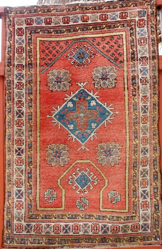 """An eighteenth century western Anatolia prayer rug, 42"""" X 66"""". A rare so called keyhole or re entry design. Original untouched condition."""