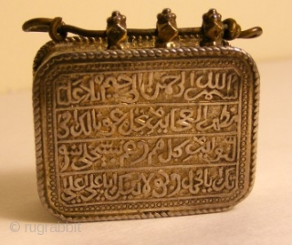 Koran Box with Inscription of Koranic Verses  A rare Koran box worn as a amulet pendant. The inscription of Koranic verses are in TUGHRA form and are reposed .Box is provided with four delicate  ...