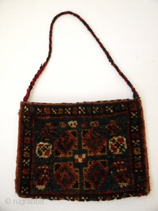lovely little chanteh (vanity bag). South Persia, very nice natural colours, good condition. The motif in the middle looks like the @ symbol.  18 x 25 cm