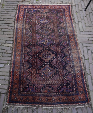pretty rare Baluch rug with beautiful natural colours and beuatiful shiny soft wool, some corrosion, traces of use, one restauration, but still a quite strong rug with kilim ends and sides intact.  ...