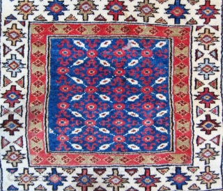 Very unusual Veramin bagface. At least I am pretty sure based on the weave that it's Veramin. The design however is much more like that seen in a lot of Kurd bags.  ...