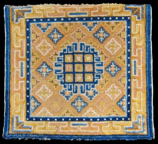 Very unusual Chinese square, circa 1800 or earlier. Full pile with really good wool and color. Missing top guard border, but easy repair if desired.