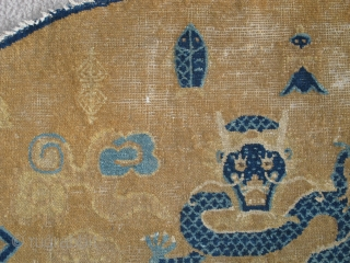 Large Chinese Ningxia Throne back with dragons, probably Kangxi period. About a meter wide. sides complete with weft returns, perhaps two inches missing from bottom, eccentric knotting, great drawing.