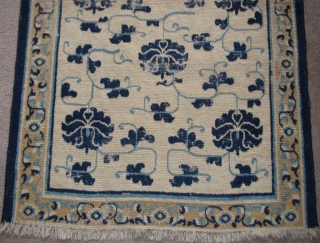"Sweet White-Ground Chinese Ningxia Rug, blue peonies and arabesque with a minimal border. hand-spun cotton warp and weft. very soft wool pile. size is 3'6""x5'7""."