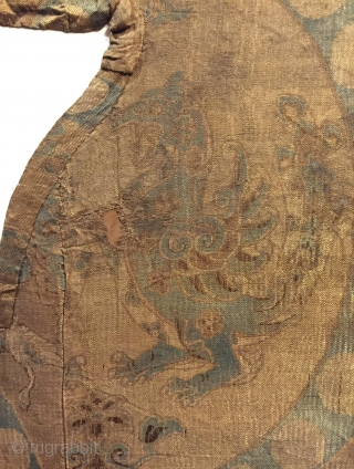 Tang Dynasty silk fragment with a large composite dragon in a pearl roundel. Central China, 8th century. An unusually rendered dragon perhaps based on Sasanian Persian or Sogdian prototypes?