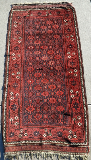 Boucher-esque Khorosan Baluch rug with Memling tile design. Animals drawn all over the place including the field, border, and even within the flatwoven ends. Good state of preservation with sides and ends  ...