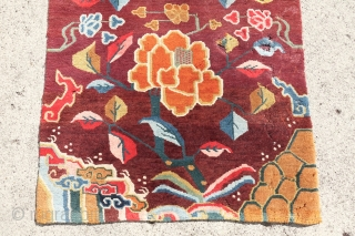 Antique old world Tibetan, exceptional collectors piece with a cheerful color combination, moth holes, backed with a textile and wall hanging rings, nice rug, 80cm x 167cm or 2'6 x 5'5.   ...