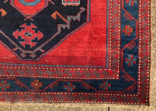 A 19TH century Caucasian rug, with two octagonal medallions with unusual internal designs, including smaller octagons at their centers with star and crescent moon symbols.  The small rectangles with saw-tooth edges  ...