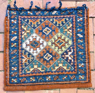 A Shahsavan pile bagface with field design most commonly seen in reverse sumac technique.   A series of closure loops made of plaited blue wool are attached to the top edge—these  ...