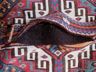 """Anatolian AlaCuval.  48"""" x 40"""" (122cm x 102cm).  Sumak and striped plainweave, Handling strap still attached---a colorful, thick, doubleweave band with intricate design, which overlies another brown goathair plainweave band  ..."""