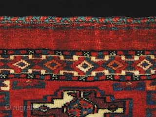 Yomut torba, complete with back and in excellent condition. Good dense pile. 35 inches by 16 inches (89cm x 41cm).  Good natural colors.  A few very small pink elements in  ...