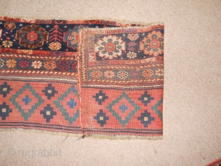 3.7 x 1.4 fragment, probably the pile end and kilim back of a substantial bag.  Exquisite color and drawing.