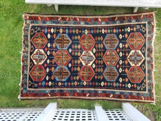 Baktiari area rug with great color and spacious drawing.  Overall low pile with ends unravelling.