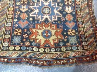 Antique lesghi star design shirvan carpet, 253x166cm, country house find, showing some dye erosion and repairs.