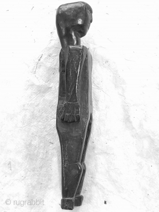 """Old doll or amulet, hand-carved from fine-grained hardwood, polished to a smooth gloss from wear and use.  Collected about 1990 in Nepal by Himalayan Antiques, inventory number 30520.  h 9"""" x w  ..."""