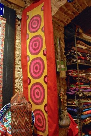 Early 20 th. century Uzbek Tashkent suzani fragment,mounted on red cotton fabric.silk embroidery size 178 x 35 cm..
