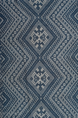 Dong minority textile from Guizhou province, Southwestern China. Indigo cotton supplementary weft weaving on cotton foundation. Woven in 3 panels and joined together. 116cm x 186cm. First half of the 20th century.  The  ...