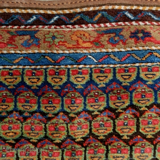 Cheerful Kurdish rug, 307x121cm, 19th century, 9 saturated, happy colours, brown corroded otherwise very good pile, glossy wool. Two old repairs, one tear at the outer border. 385 bothe faces are smiling  ...