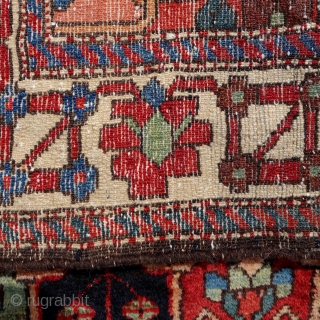 Bakhtiar from the village Âbâdji, circa 1900, 200x143cm, rare border, saturated colours, including beautiful pistachio green, good pile all over, damage in the middle field, 3 tears in the upper and bottom  ...