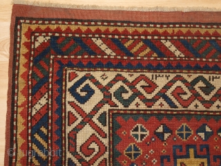 Antique Caucasian Kazak rug of small size with four Memlinc guls. www.knightsantiques.co.uk   Size: 5ft 2in x 2ft 11in (158 x 90cm)  Circa 1900.  A sweet small Kazak rug with a single vertical row of  ...