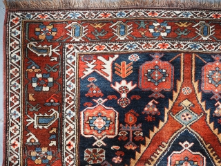 Antique Kurdish long with elongated single medallion design. click the link www.knightsantiques.co.uk to view more items.  Circa 1900 Size: 7ft 0in x 4ft 7in (214 x 140cm).  A charming old rug with a very  ...
