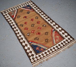 A fine kilim of small size by the Luri or Bakhtiari tribe. www.knightsantiques.co.uk  Size: 3ft 9in x 2ft 3in (115 x 68cm).  Circa 1900.  A sweet little kilim with the field woven in camel  ...