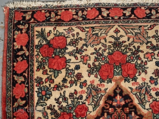 Antique Bijar rug of small pushti size, the rug is beautifully drawn with a small medallion surrounded by roses on an ivory ground. www.knightsantiques.co.uk  Size: 2ft 4in x 2ft 3in (72 x  ...