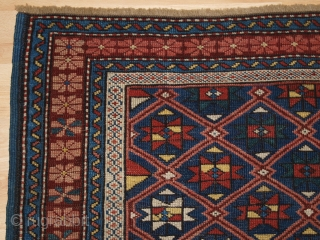 Antique Caucasian Seichur rug with star and lattice design. www.knightsantiques.co.uk   Circa 1880.  This charming rug has a dark indigo blue field covered with a fine diamond lattice, with each diamond containing a eight  ...