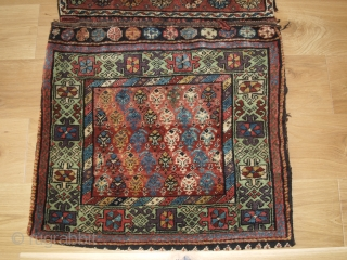 Antique Kurdish Varamin region Khorjin with plain weave back. www.knightsantiques.co.uk   Circa 1900.  The saddle bag faces are drawn with a diagonal repeat boteh design surrounded by a Turkmen inspired design border on a  ...