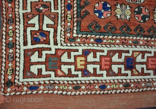 An antique Canacale rug, Bergama. 19th century. Low in places, but quite a lot of pile, fat kilim one end, origanol side cords. Hanging loops to reverse. needs a good wash. 213  ...