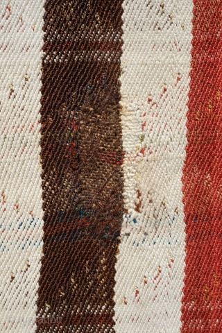 Qashqa'i Mowj, Late 19th Century.  All good colors.  Small tufts of wool decorating the field.  Wonderful twill weave.  A small repair in one of the brown stripes as  ...