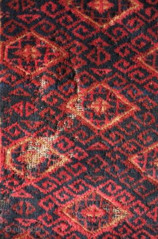 Baluch rug, Khorasan, Torbat-e Haidari area, 3rd Quarter of the 19th Century.  Soft wool like lamb's wool.  Archaic looking linked border motif.  Some moth eaten areas and wear on  ...
