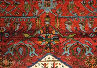 Hamadan Rug, Early 20th Century.  Exquisite central medallion with a vase, bouquet and small animals.  The surrounding foliage on either end and ghostly green botehs cupped in leaves are masterfully  ...