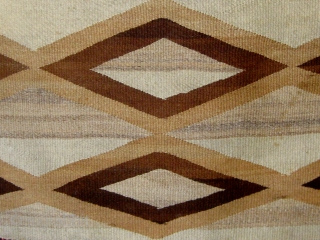 "Antique Navajo weaving (first quarter of the 20th century) incorporating both tapestry and twill weave, 39"" by 65"", natural wool colors with aniline dyed red wool."