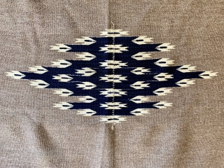 Antique Chimayo Rio Grande child serape, first quarter of the 20th century or earlier, finely hand woven of hand spun natural and indigo dyed wool.  Please ask for additional photos.