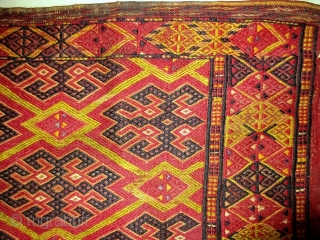 Antique Ersari Turkmen brocaded torba with a lot of silk--at least three colors including mauve, lemon, and the pale green that forms the main lattice design (see last photo).  Complete with  ...