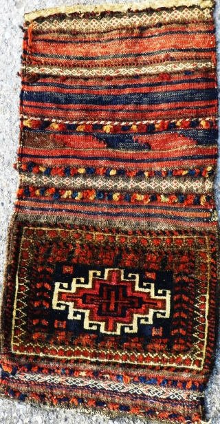 Antique Baluch chanteh, opened, circa 1900.  A lovely little  gem with a great patina. Original sides and ends.  Please ask for additional photos if needed.
