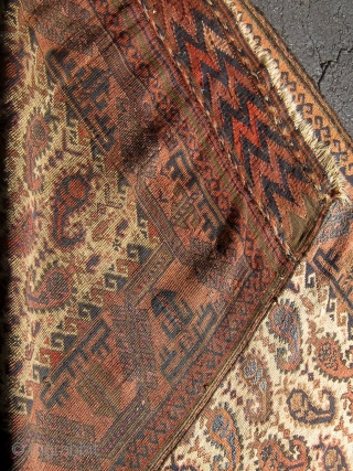 Rare antique Baluch runner with beautifully drawn botehs on a pale camel field.  Lovely shades of pale, medium, and dark blue.  Original flat woven ends and sides.  All colors  ...