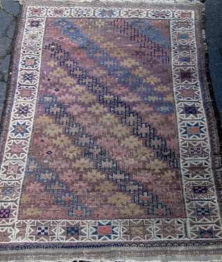Antique small Baluch rug, symmetrically knotted, with a lovely array of light shades including aubergine, various hues of blue, rose, violet, etc.  Complete with kilim ends, all dyes appear natural with  ...