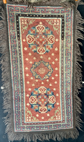 """Antique Tibetan khaden, 19th century, all dyes natural including beautiful rose and apricot.  Three medallion pattern with double dorjee medallions flanking the central Chinese inspired figure.  53"""" by 28"""" not  ..."""