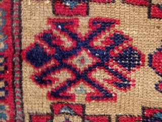 Antique Western Anatolian Kurdish yastik, golden ground, with three  shades of blue, highly saturated red, etc.  All dyes appear natural.  Circa 1890-1910.  Original sides.  All wool construction.  ...