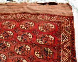 Turkmen Kizil Ayak Main Carpet. Sides ends original. Minor wear and staining in places - see pictures. Mid 19th Century.  Size: 350 x 227 cm  the carpet is in good condition for age, except  ...