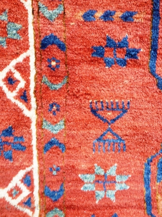 Turkmen main carpet of exceptional colours with archaic motifs throughout and a wonderful soft wool and floppy handle. 240cm x 205cm  This item is available for viewing at the following event:  http://www.pa-antiques.co.uk/londonantiquetextiles_vintagecostumes_tribalart_fair.html