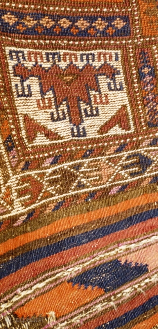 Archaic Afghan prayer ? rug. Possibly Baluchi and in a very worn state however could be hung. Displays Turkoman motifs. Has one kilim end with float weave details. Other end missing and  ...