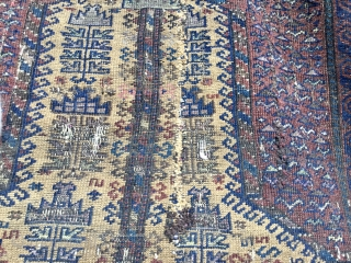 Old, worn, Afghan Baluch tree of life, camel ground prayer rug. Wool on wool with Numerous silk highlights: white, lime green, mauve, pink, etc. Holed and damaged. Original sides and ends. Size:  ...