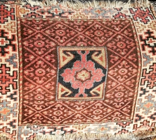Antique Persian Fragmented Bagface, a/f with low pile and losses. Size: 24in X 22in	61cm X 56cm